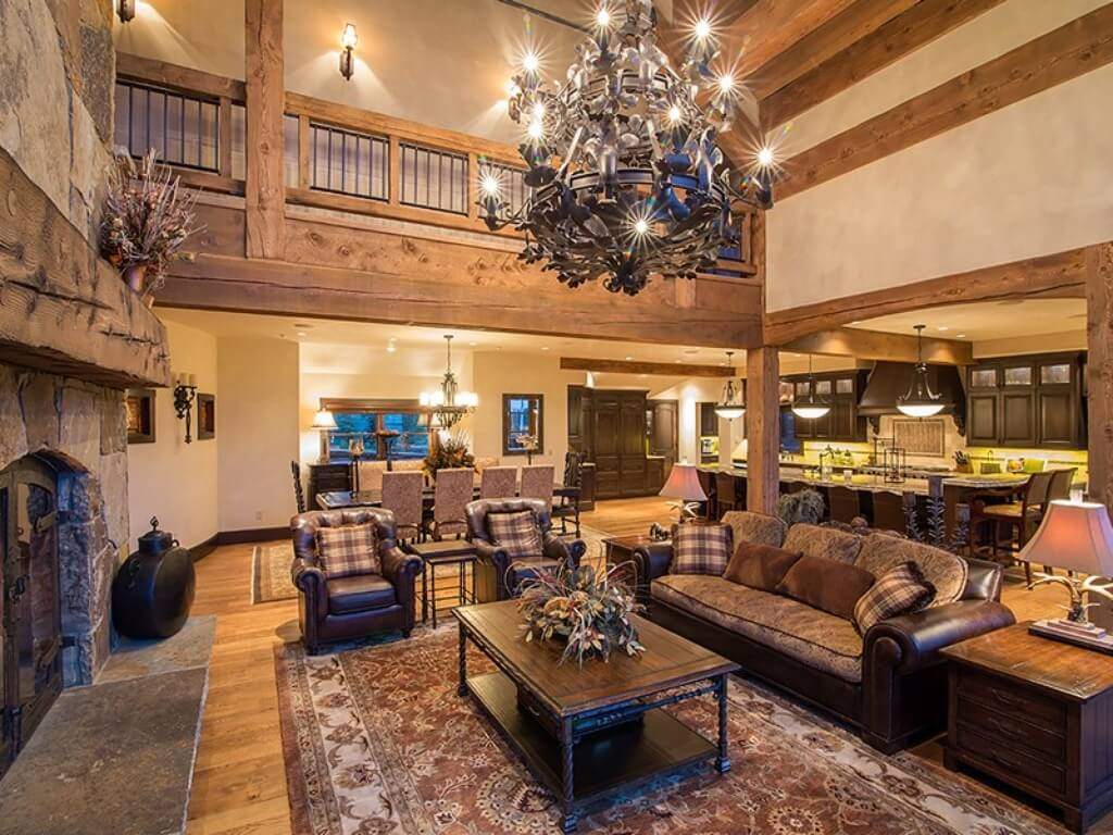 Superieur This View 0f The Living Room Highlights The Massive Stone Fireplace With  Natural Wood Mantle On