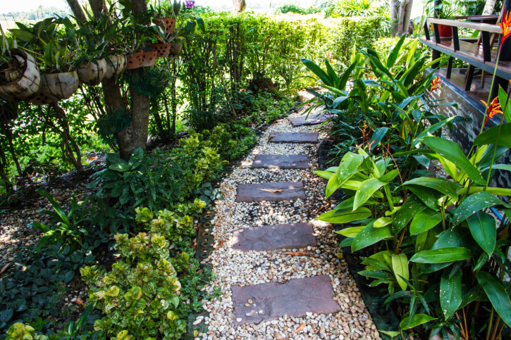 Wide Pebble Bed Supports Rectangular Flagstone Pieces In This Garden Walkway .