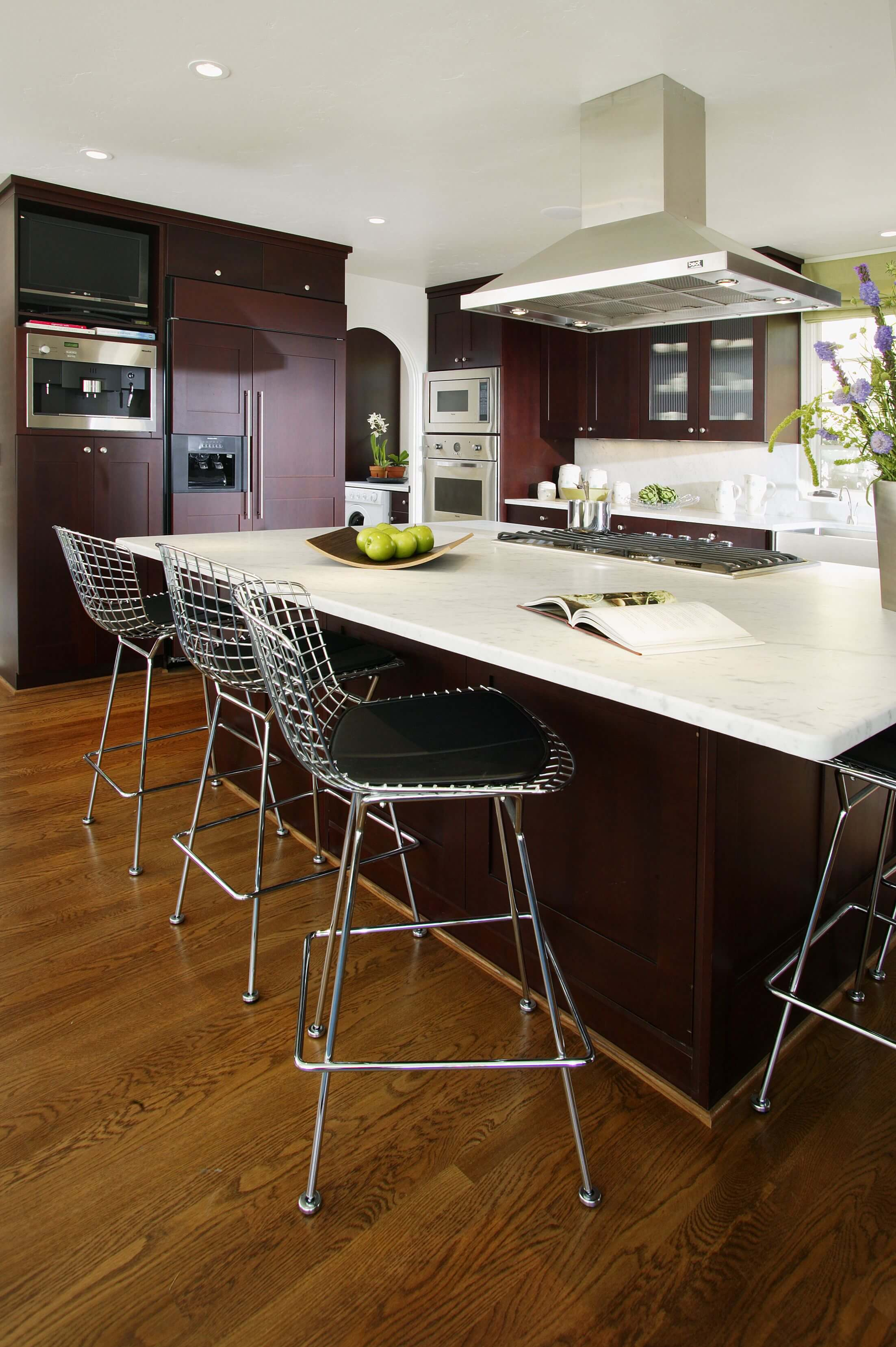 High Contrast Look In This Kitchen Courtesy Of Dark Stained Cabinetry White Countertops