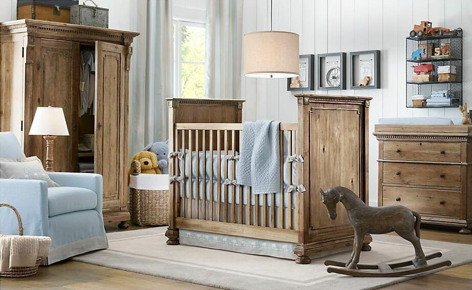 nursery flush with natural wood materials from dresser to high walled crib to wardrobe on blue nursery furniture