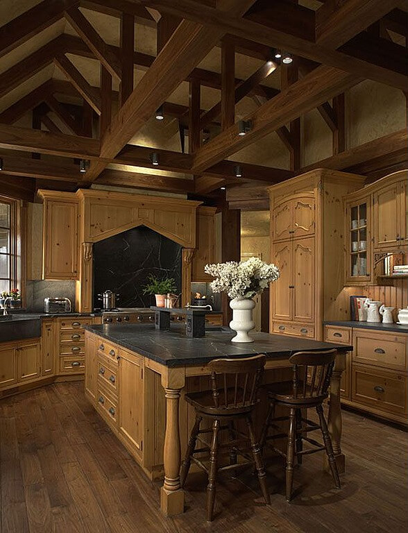 singular tone of natural wood cabinetry unifies this kitchen sandwiched between dark exposed ceiling beams - Kitchen Designs Dark Cabinets