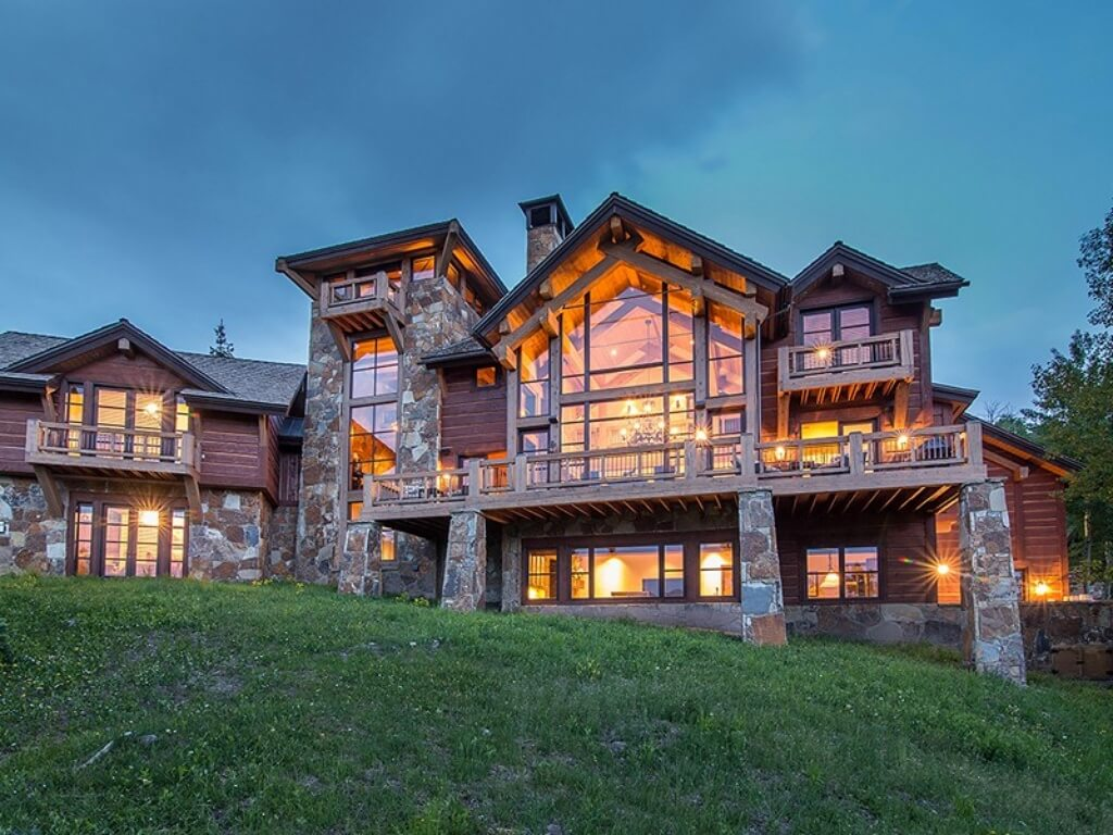 Log and stone colorado ski chalet with great room for Large front windows house