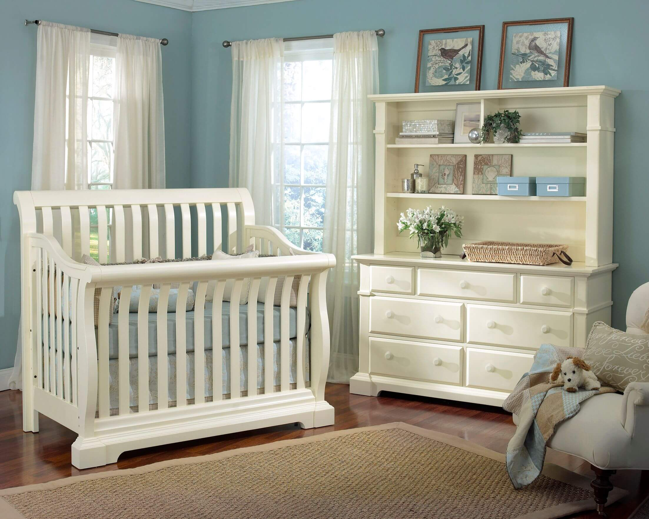 lush white wood construction crib and matching dresser stand over dark hardwood flooring in this nursery - Nursery Design Ideas