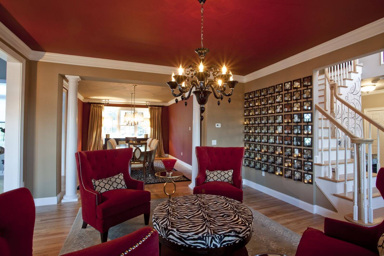 This Living Room With Red Furniture Includes A Round Zebra Print Ottoman  Functioning As A Coffee Part 44