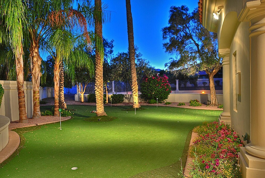 Backyard Putting Green Designs backyard with artificial turf anf golf putting green This Custom Green Wraps Around Palms In This Backyard Featuring Gentle Elevation Changes For A