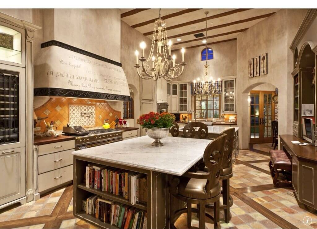 Large Ornate Kitchen Is Rich With Details Including Built In Island Bookshelf
