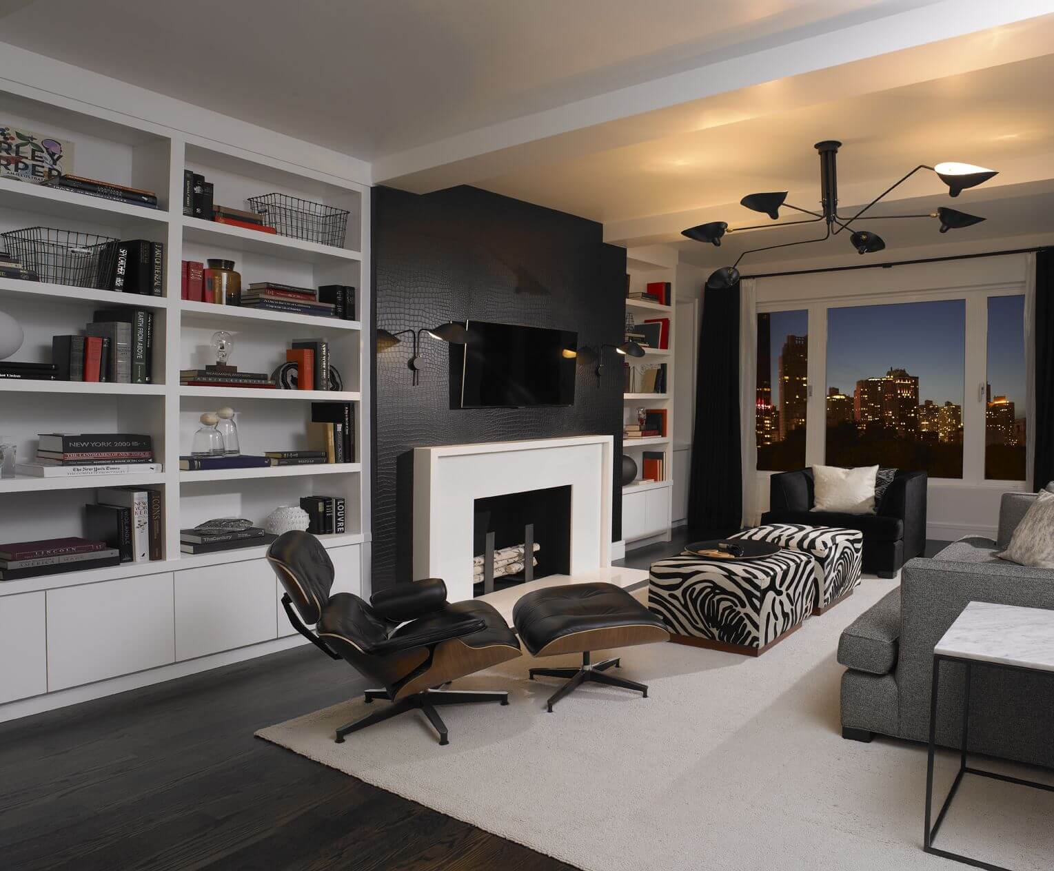 Amazing Casual Living Room In A Condo Incorporating Zebra Print With 2 Zebra  Ottomans, Both Of