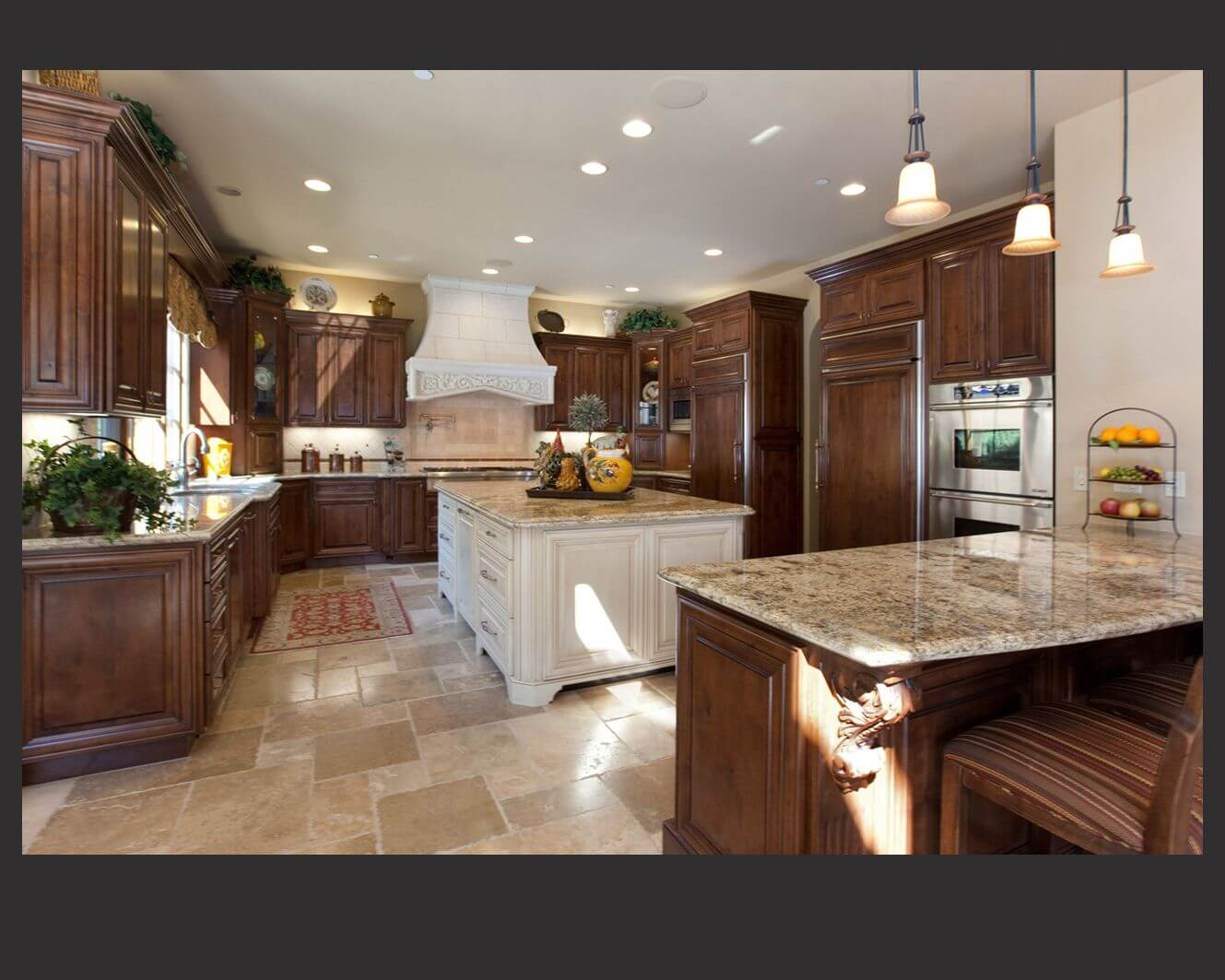 Richly Detailed U Shaped Kitchen Centers Dark Wood Cabinetry Around Large White Painted Wood