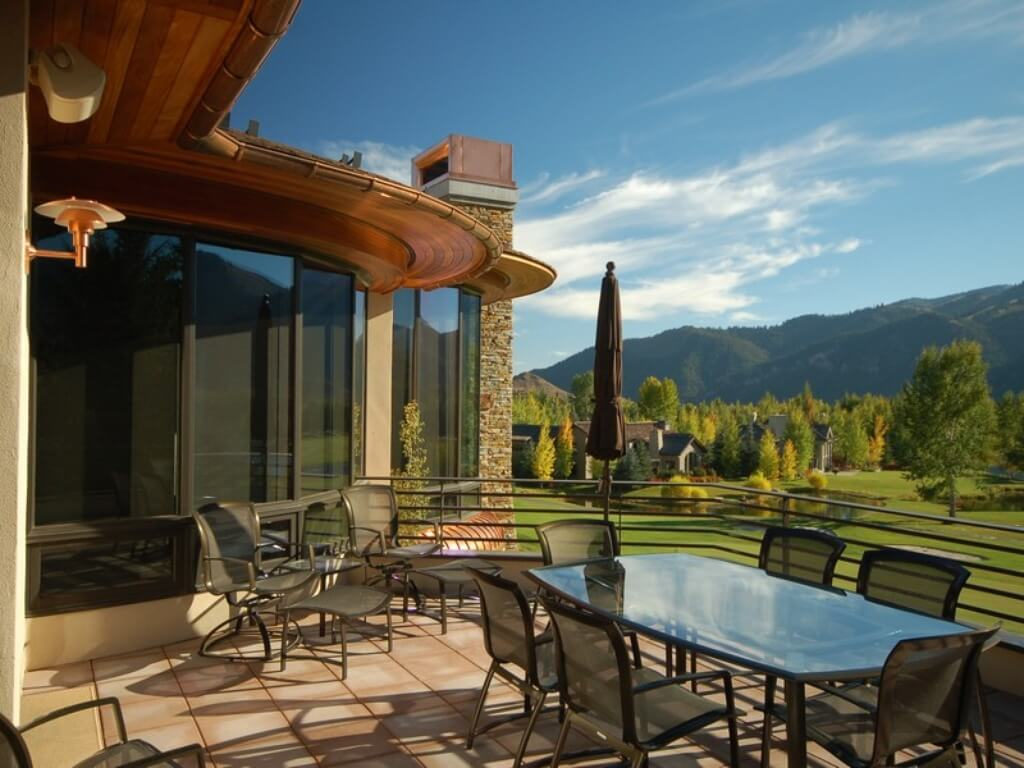 Upper patio with dining table and sitting area overlooking the golf course.
