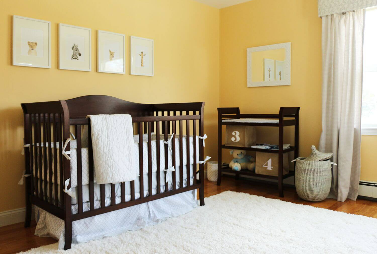 Baby cribs with matching dresser - Banana Yellow Walls Stand Over Natural Hardwood Flooring With Thick Shag White Rug In This Nursery