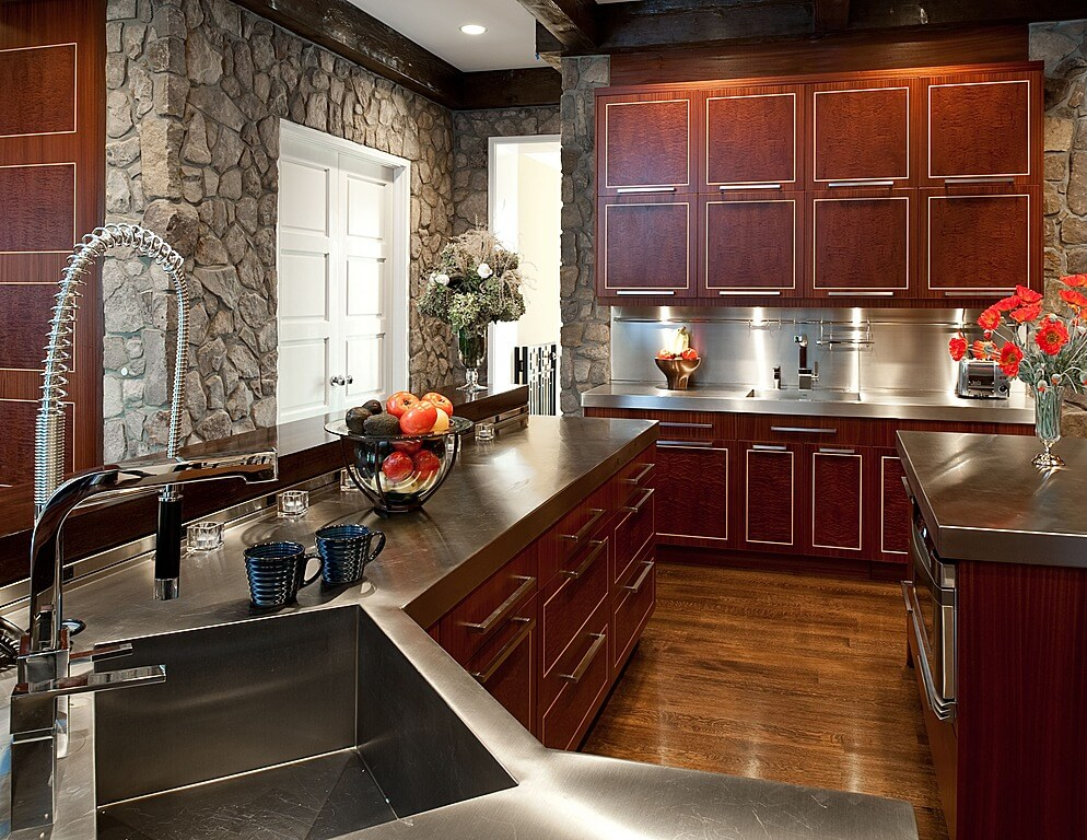 Unique Metal Countertops Surround This Kitchen Matching Cabine Hardware Over Cherry Wood Paneling With