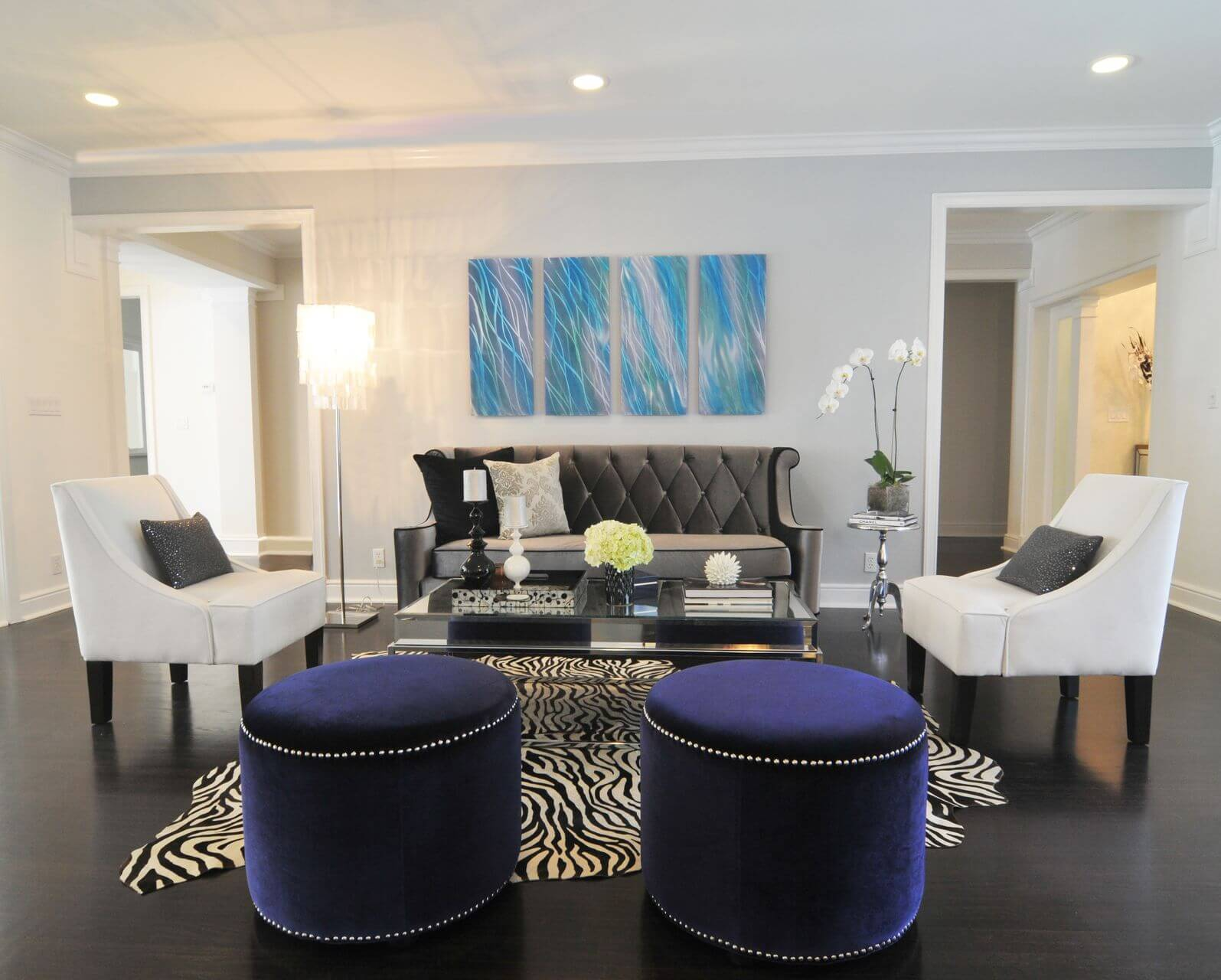 Small Contemporary Living Room With Dark Floor On Which Is An  Abstract Shaped Zebra Print