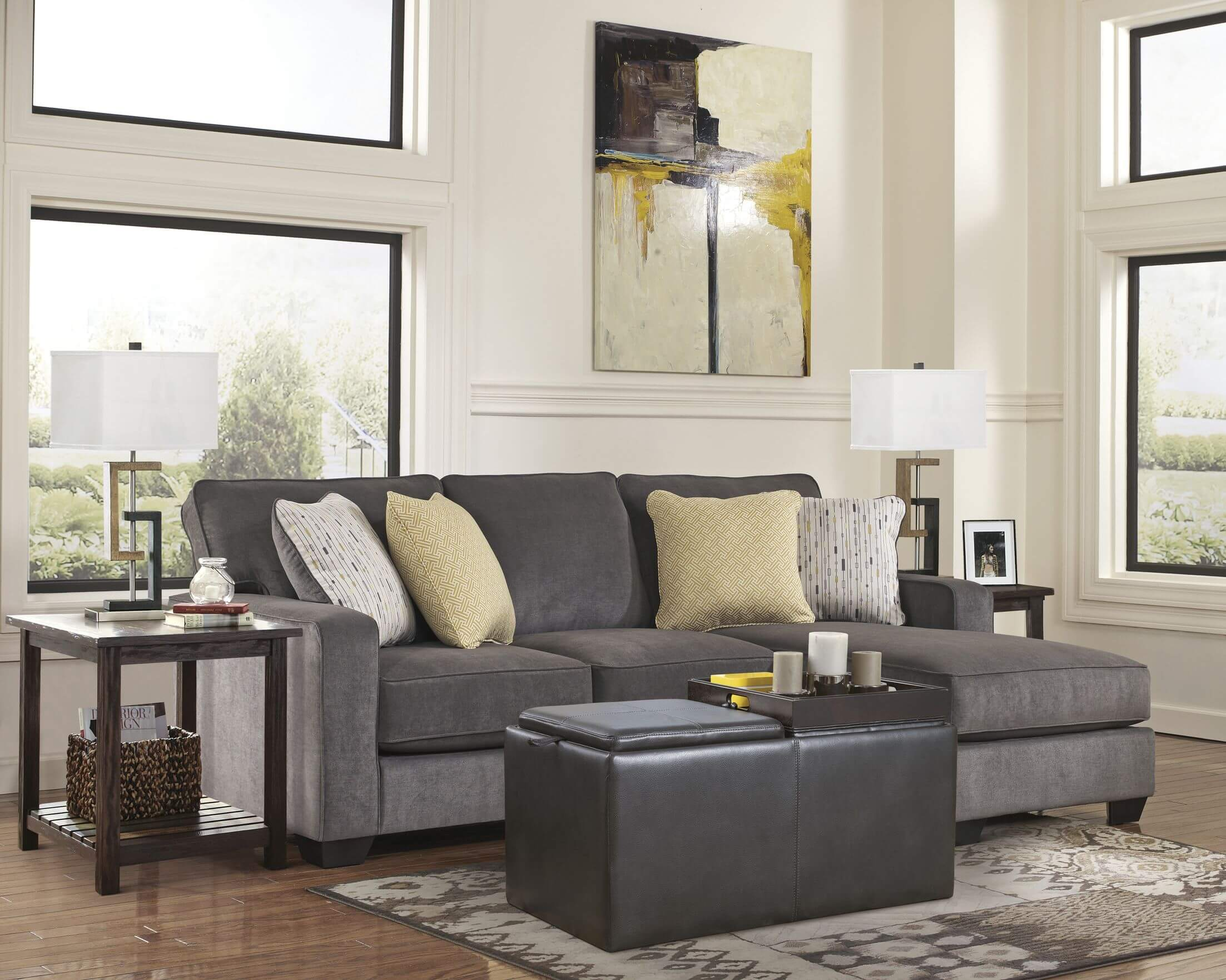this cozy space features a simple and direct cushion backed sectional couch with built in