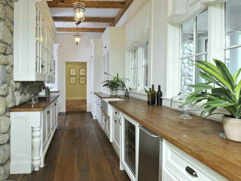 white galley kitchen with natural wood countertops - Gallery Kitchen Ideas