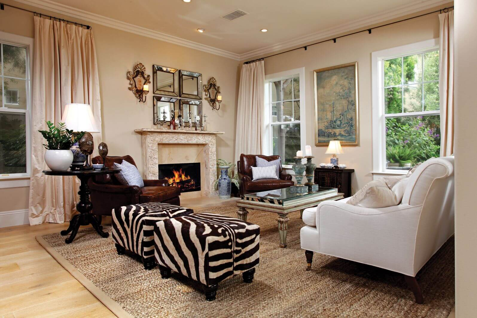 Larger Formal Living Room Incorporating Zebra Print With Two Identical Zebra  Print Ottomans Off To The