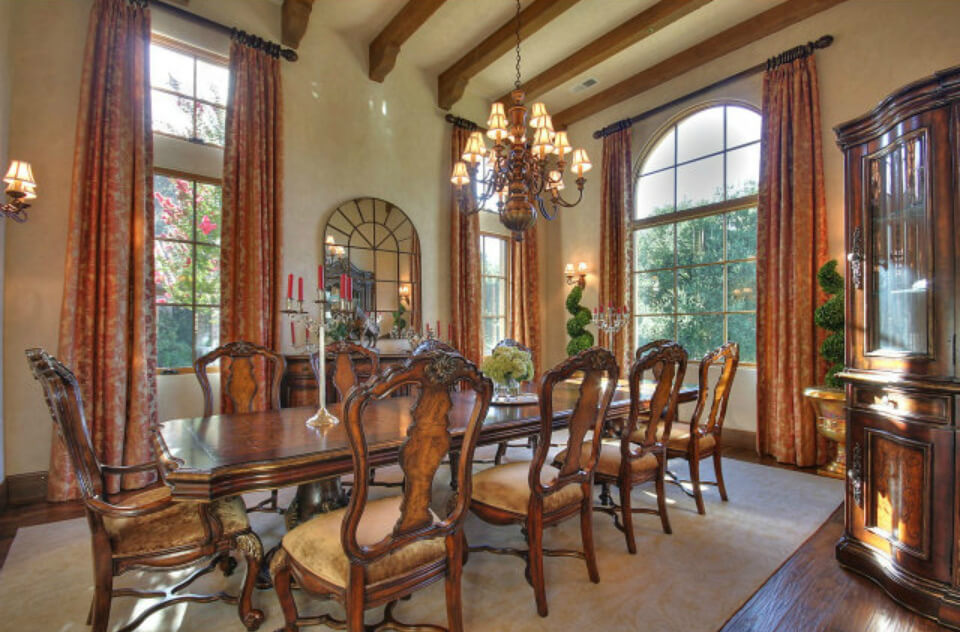 Formal dining room that comfortably accommodates 10 people.  As you can see this room shows well with large antique furniture.