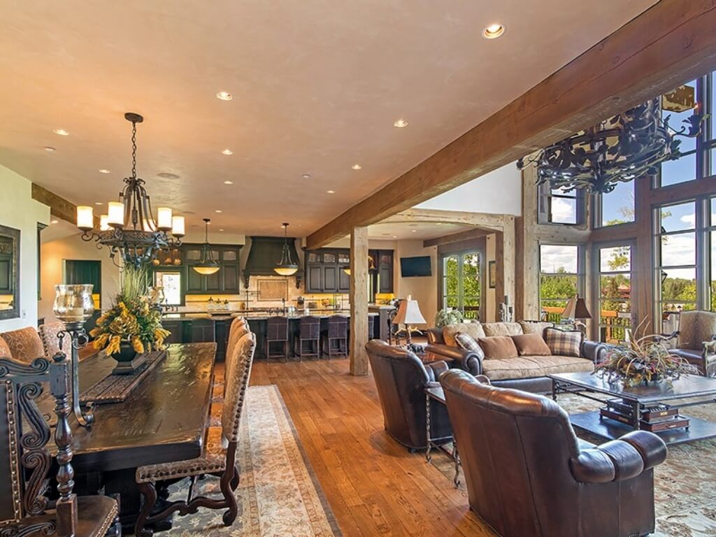 Open Design Central Living Room Framed In Massive Exposed Natural Wood  Beams, Featuring Ornate Dining