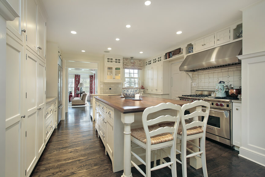 Here S An Example Of A White Corridor Kitchen With An Island