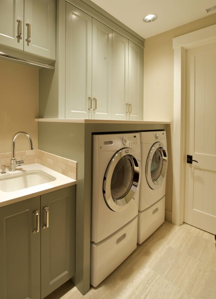 Custom home interior by nordby design studios for Cupboards for laundry room