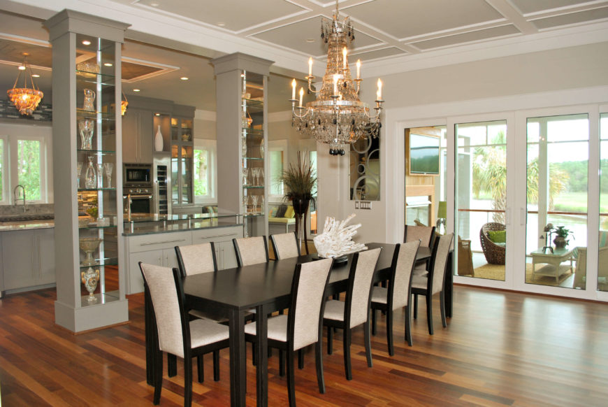 Extra Long Dining Room Table In Black With And White Chairs Elaborate Chandelier Overhead