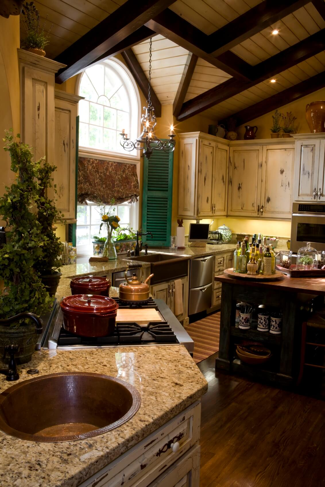 """... flooring, black wood island, and """"aged"""" painted light wood cabinetry"""