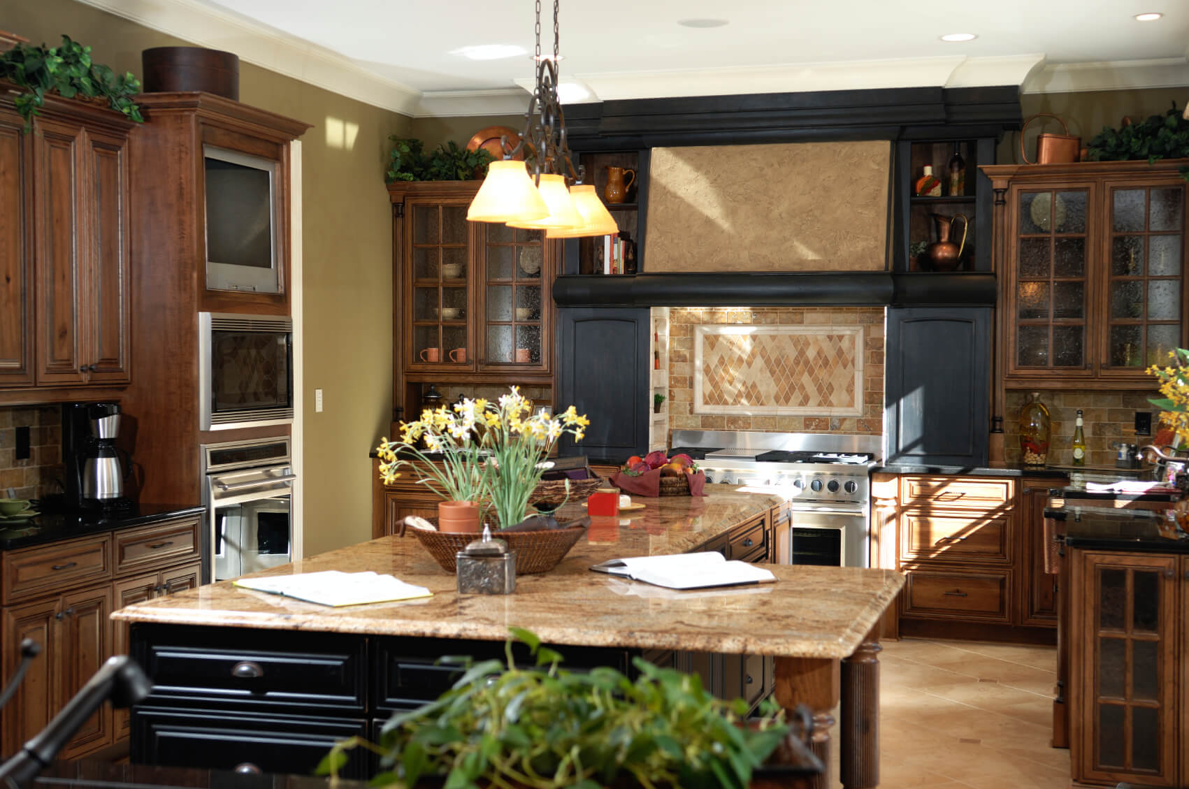 black wood cabinetry surrounds range with beige tile backsplash in this detailed kitchen l