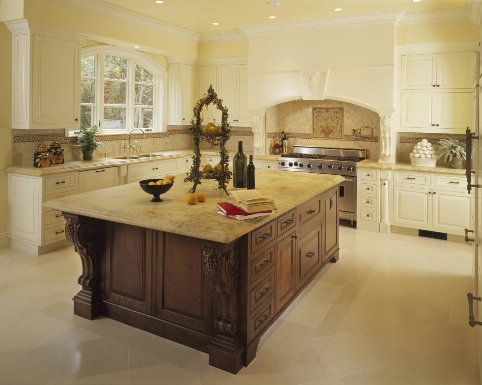 Clean beige textures throughout this kitchen, including marble ...