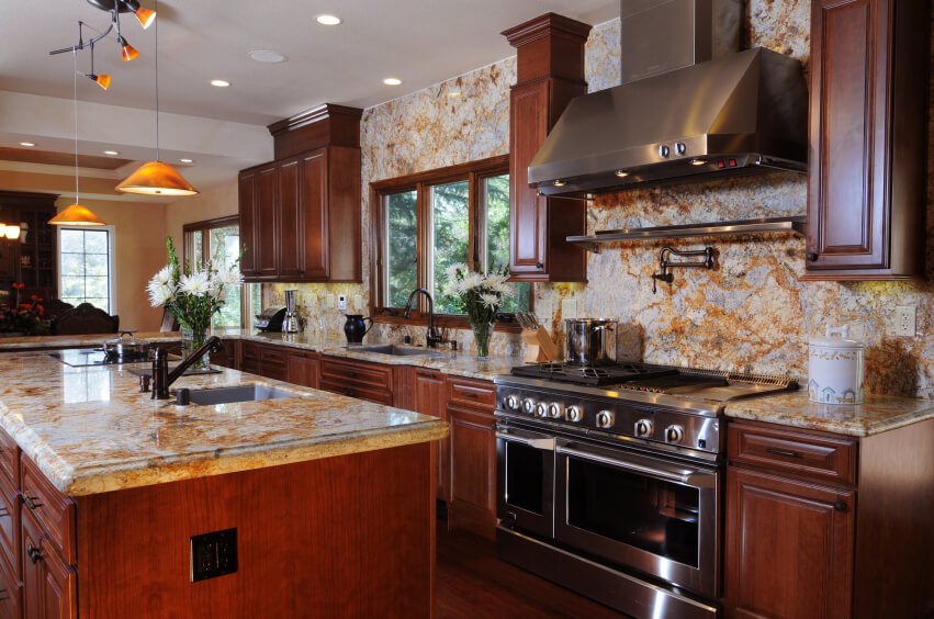 Bold Use Of Light Marble On Countertops And Entire Wall Extending From  Backsplash Space Stands In