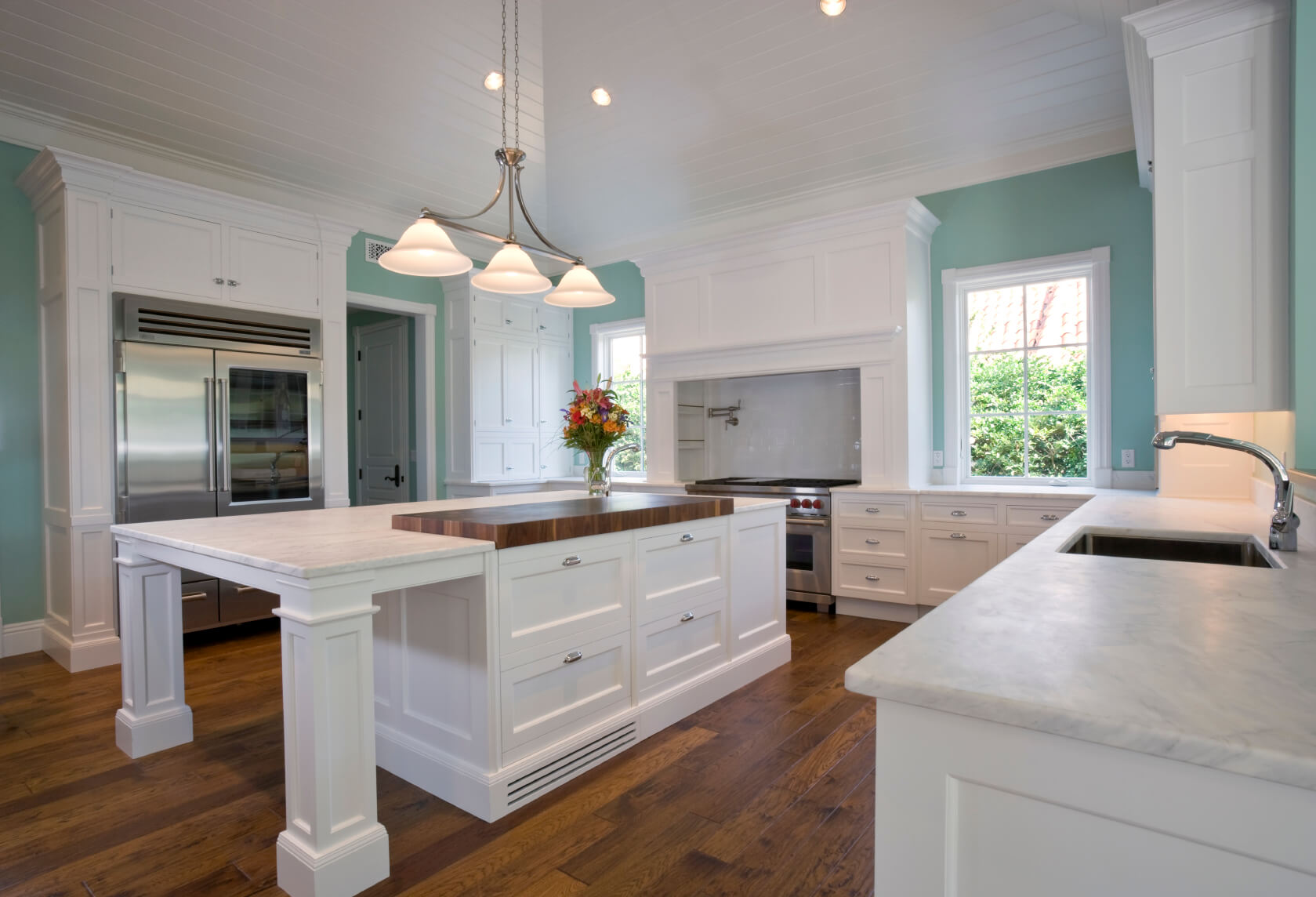 white kitchen designs pictures hardwood floor in kitchen Light mint blue paint adds burst of color to this all white kitchen over natural