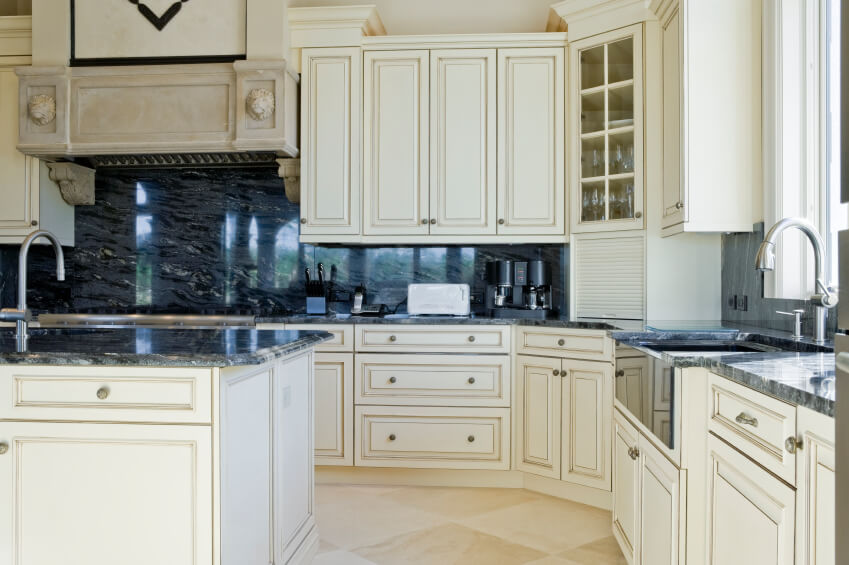 surround dark blue marble backsplash and countertops in this kitchen