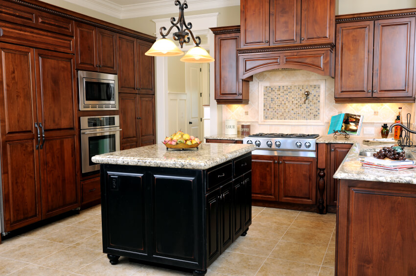 Cherry Wood Cabinetry And Beige Tile Backsplash And Flooring Contrast  Neatly With Black Island Featuring Thick Part 91