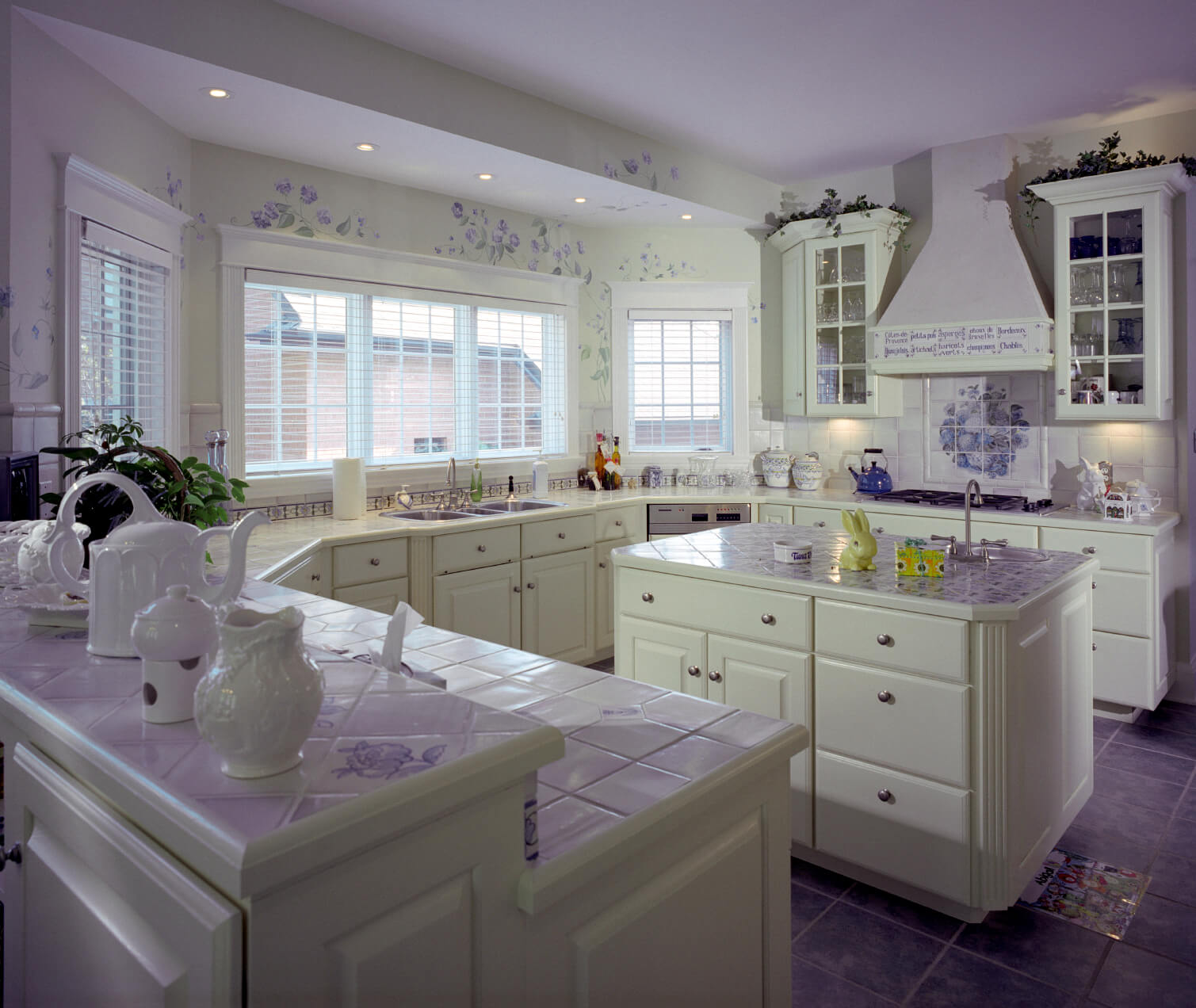 white kitchen designs pictures white kitchen countertops This white kitchen is enlivened by a smattering of purple throughout purple tile flooring