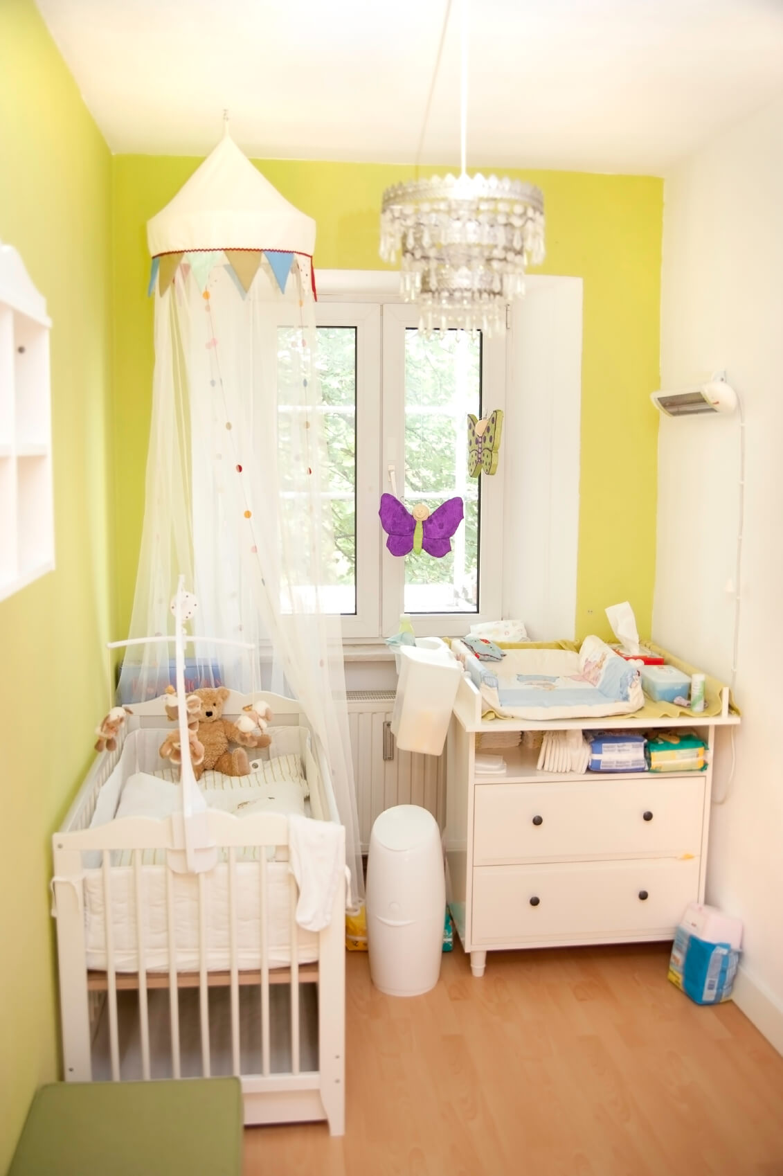 Cozy Nursery Splashed With Bright Yellow Paint On The Walls, Over Natural  Hardwood Flooring,