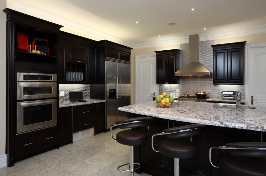 Kitchen Is Great Example Of High Contrast Between Dark Toned Wood Cabinetry  And Light Marble Surfaces