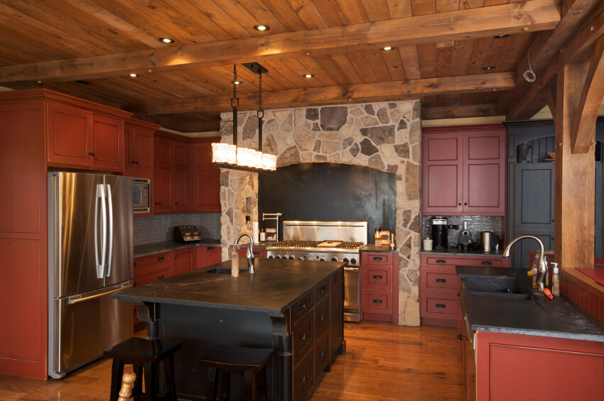 Here S Another Lush Rustic Styled Kitchen With Dark Red Stained Cabinetry Under Black Marble