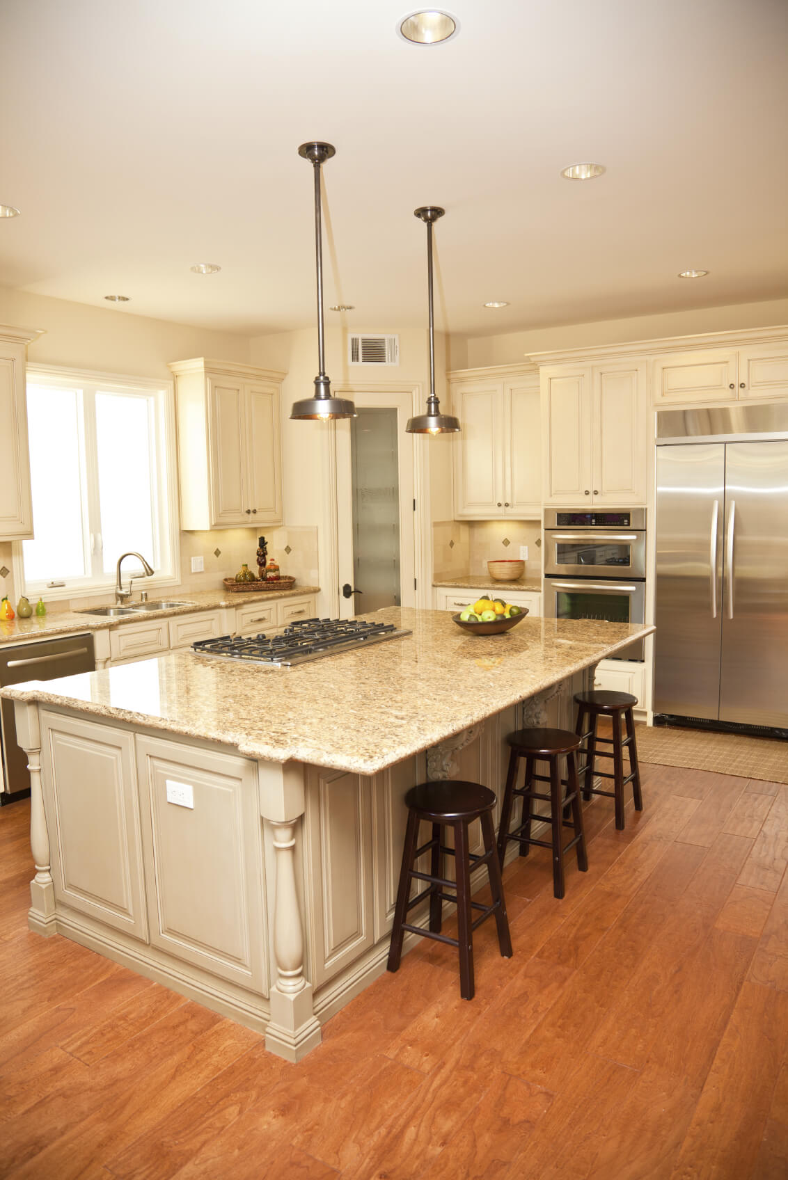 Kitchen island photo of a luxurious beige tone island features wide