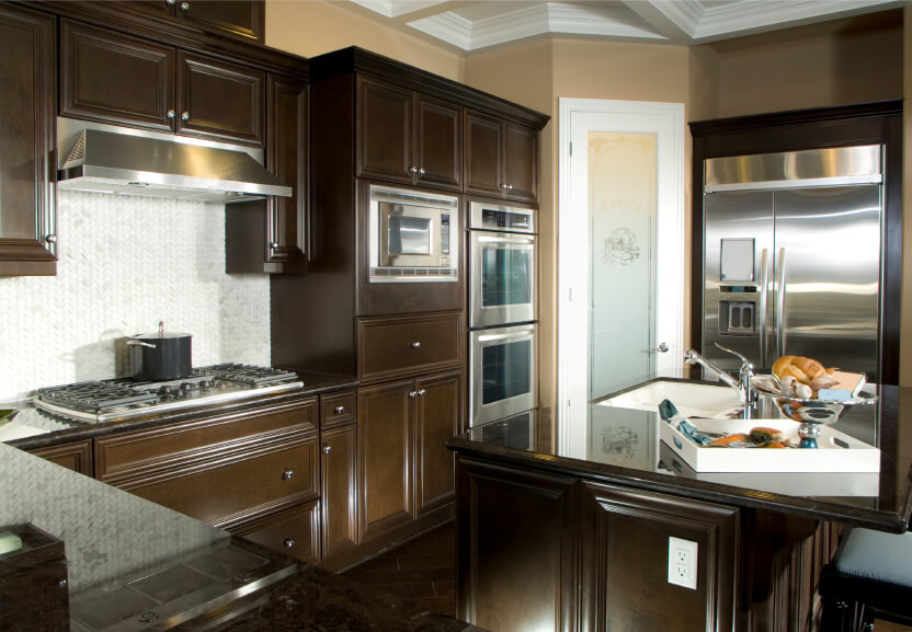 Dark Chocolate Wood Cabinetry Surrounds White Tile Backsplash Over Flooring In This Cozy Kitchen