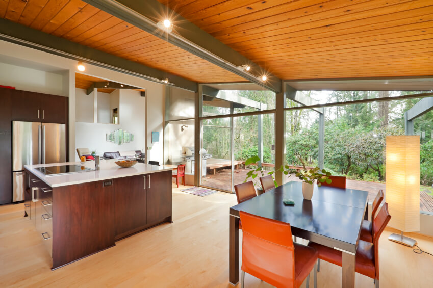 Ultra Modern Kitchen Using Traditional Materials Light Wood Sloped Ceiling Floor To Glass