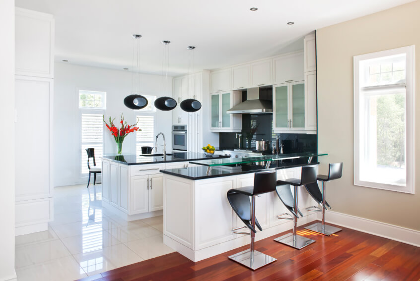 Ultra Modern Kitchen Here Features Contrasting Natural Wood And White  Marble Floorings, With Bright