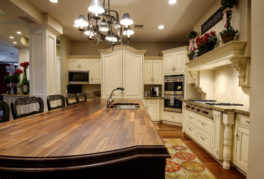 of natural wood countertop with built in sink and large seating area