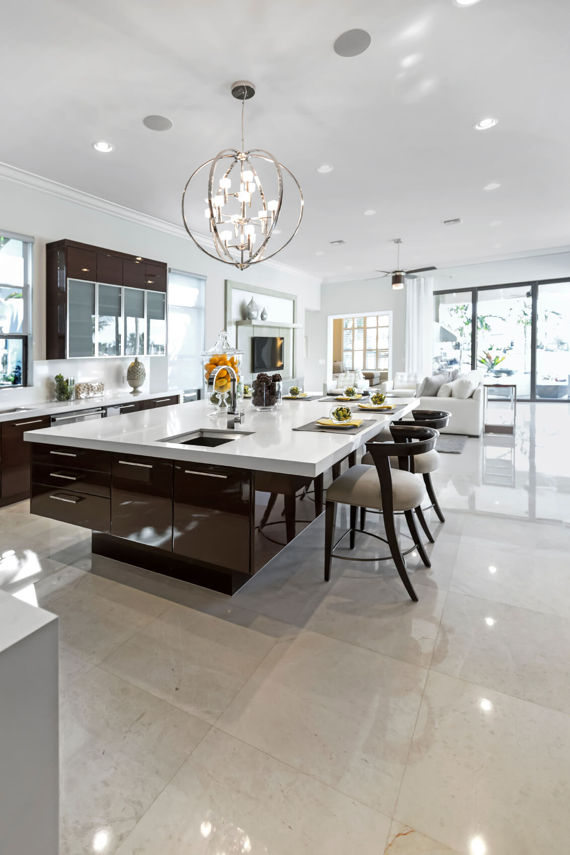 large modern white and dark brown kitchen with huge modern island with