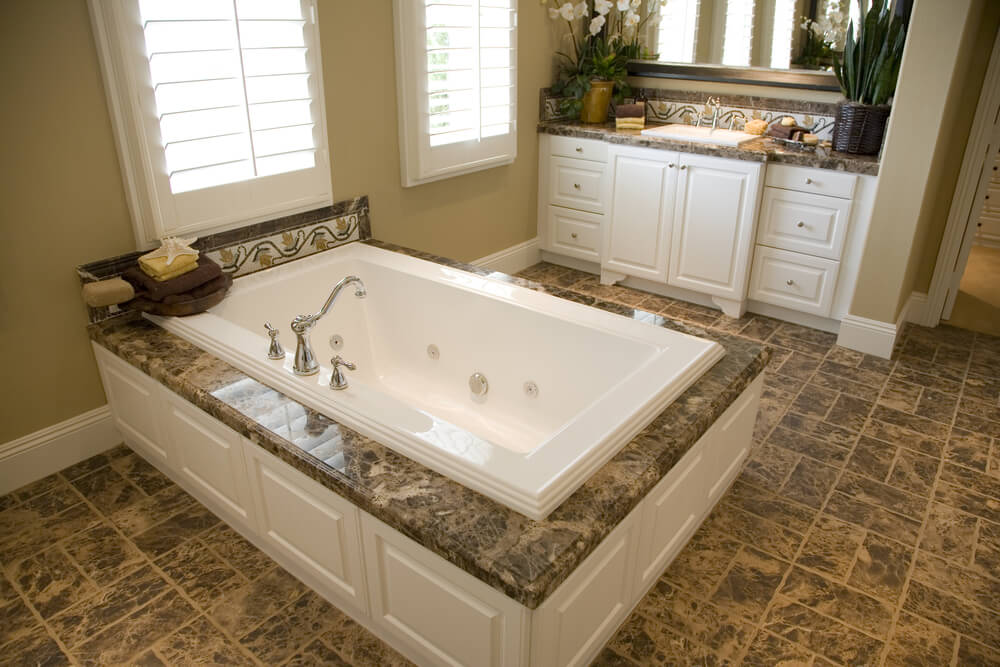 24 luxury master bathroom designs with centered soaking tubs for Limestone bathtub