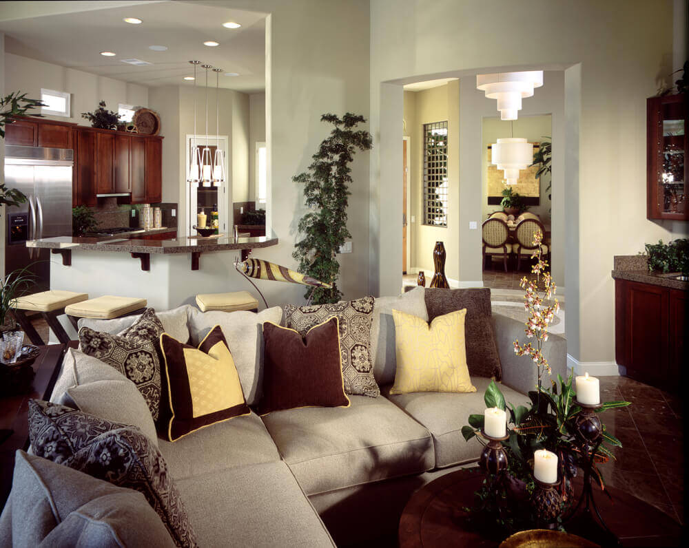 This Cozy But Open Living Room Space Holds Contemporary Grey L Shaped  Sectional With Decorative