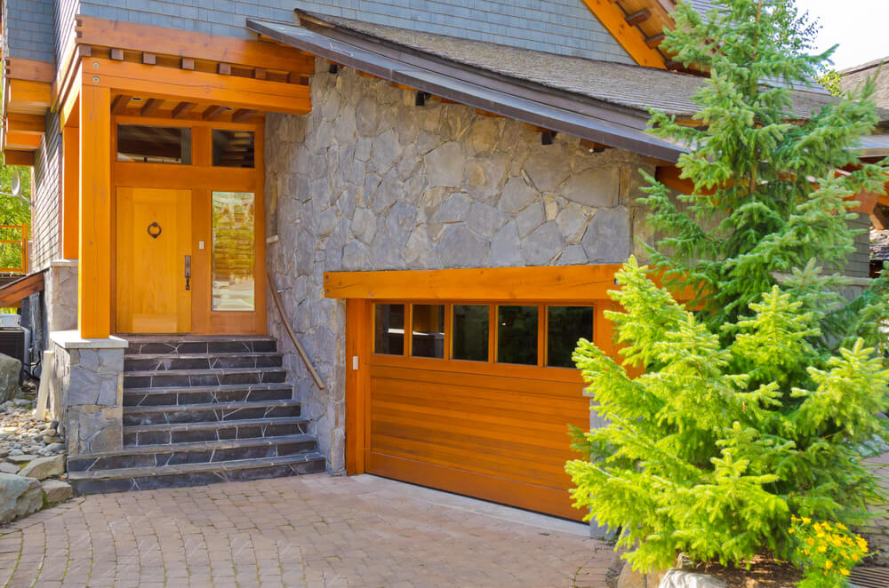 Stone Facade Home Features Bright Toned Natural Wood Throughout Structure,  Including Side Facing Garage Door