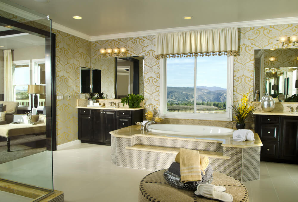 Luxury Master Bathroom With Large Step Up Soaking Tub In The Center Between  Two Vanities