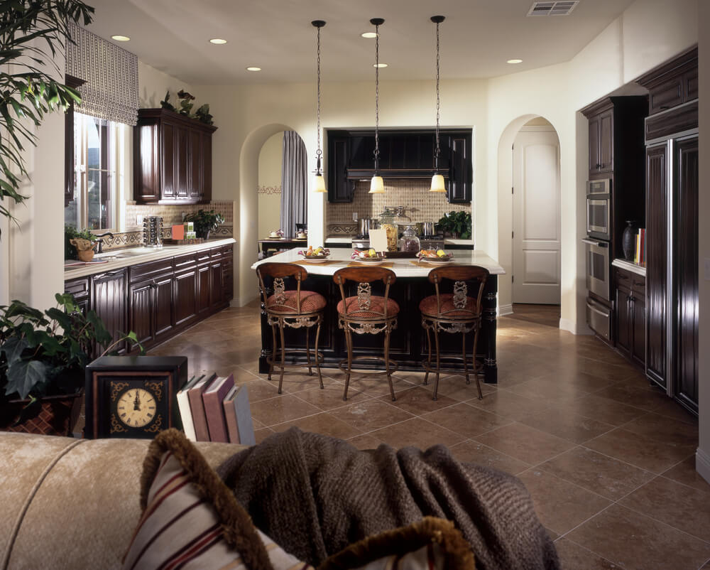 Wide Open Design For This Kitchen Includes Expanse Of Dark Marble Flooring Reaching Living Room Area