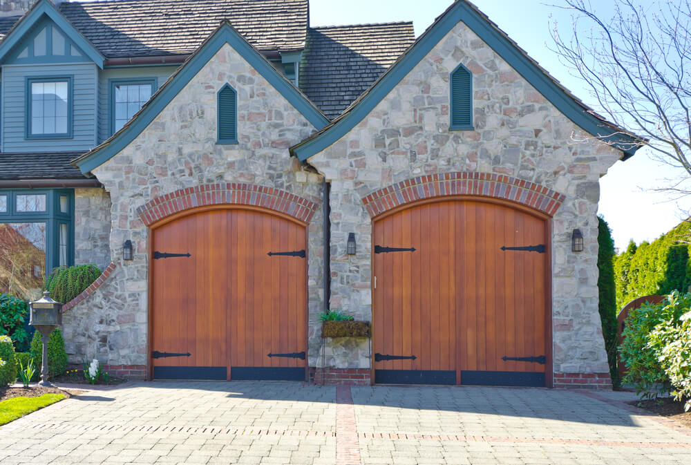Large Stone Structure Holds This Two Car Garage, Featuring Warm Natural  Hardwood Carriage Style Doors