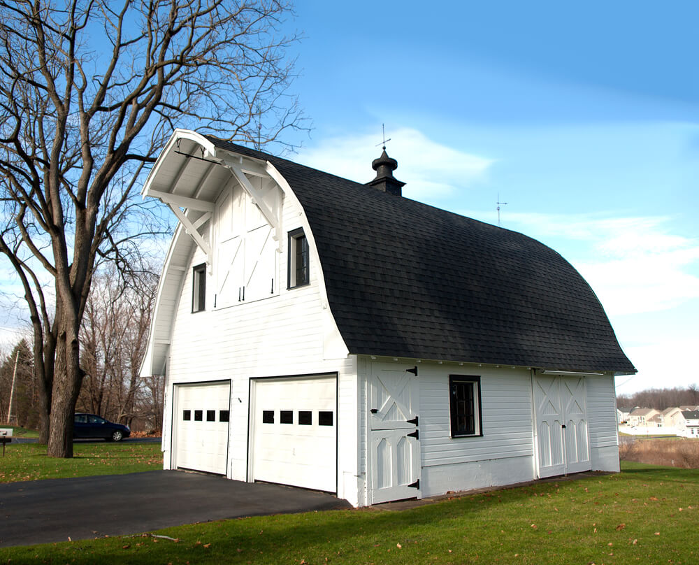 Arched Roof Barn Style Carriage House In White Features Two Stall Matching Garage Doors With 3