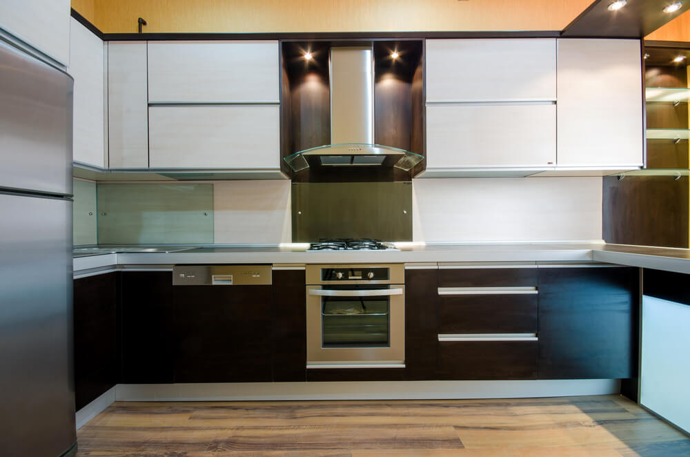 Ultra Modern Kitchen Flush With Varying Shades On Minimalist Flat Panels:  Dark Wood Lower