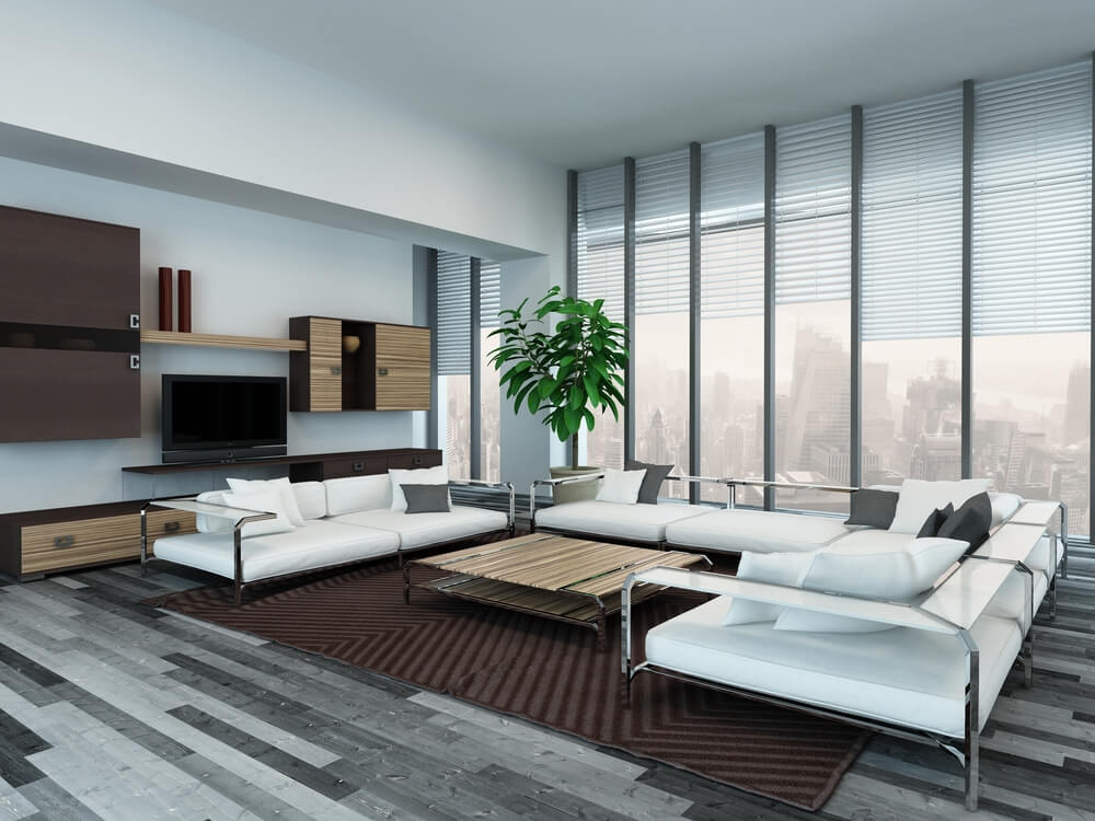 ultra modern living room features metal framed sectional with white cushions and glass shelving over grey